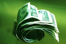 绿色背景中券动的纸币钞票